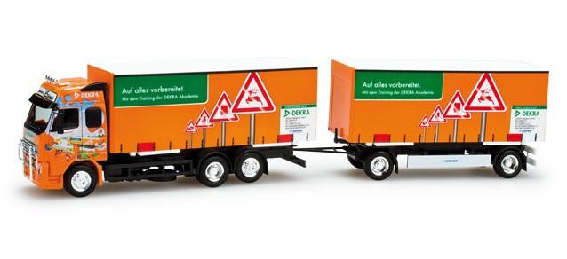 "Herpa  Volvo FH GL Wechselkoffer-Hängerzug ""Dekra/ Truck Grand Prix 2011"""