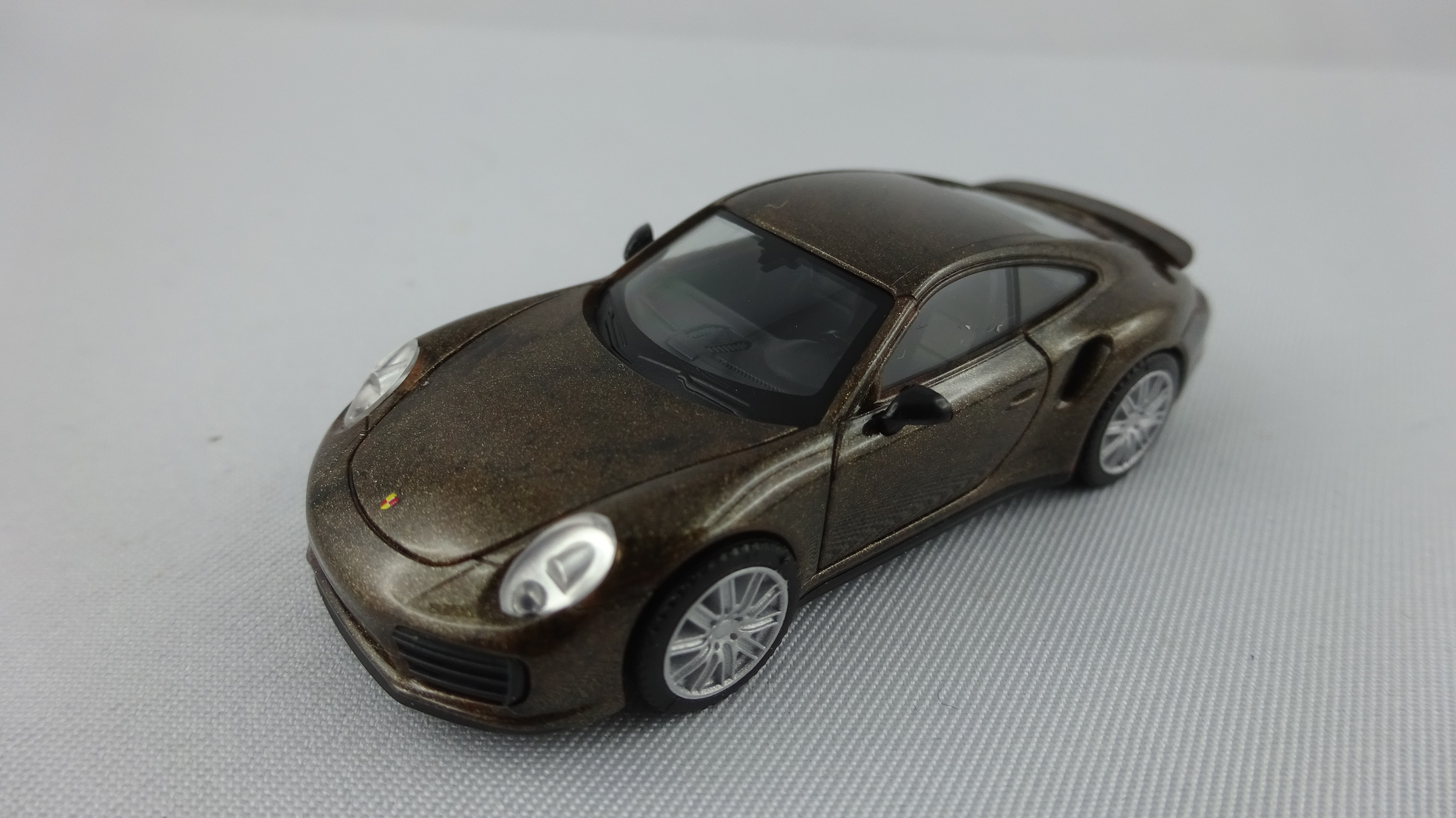 Herpa Porsche 911 Turbo (R) gold-marmor-metallic